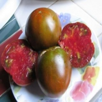 Slovenian Black Tomatoes - Whole and Sliced on a Plate